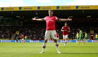 Arsenal's Aaron Ramsey celebrates scoring the first goal of the game during their English Premier League soccer match against Norwich City at Carrow Road, Norwich, England, Sunday, May 11, 2014. (AP Photo/PA Wire)    UNITED KINGDOM OUT    -   NO SALES    -   NO ARCHIVES
