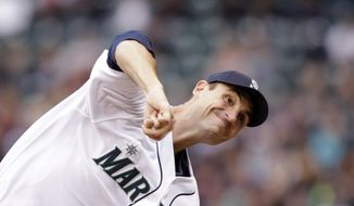 Seattle Mariners starting pitcher Chris Young throws against the Kansas City Royals in the third inning of a baseball game Saturday, May 10, 2014, in Seattle. (AP Photo/Elaine Thompson)