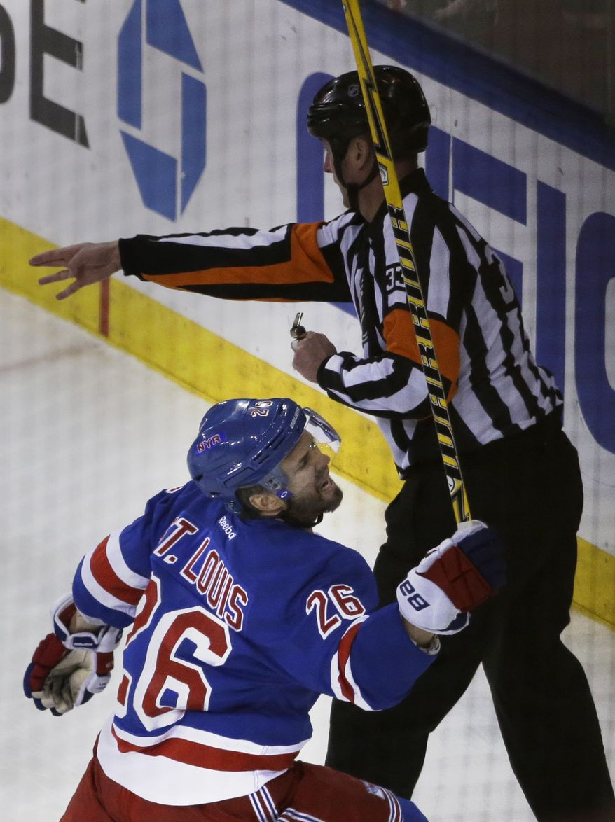 New York Rangers right wing Martin St. Louis (26) reacts after scoring during the first period of Game 6 of a second-round NHL playoff hockey series against the Pittsburgh Penguins, Sunday, May 11, 2014, in New York. (AP Photo/Seth Wenig)