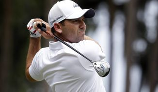 Sergio Garcia, of Spain, hits from the second tee during the final round of The Players championship golf tournament at TPC Sawgrass, Sunday, May 11, 2014, in Ponte Vedra Beach, Fla. (AP Photo/Lynne Sladky)
