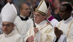 Pope Francis arrives to celebrate a Mass where he ordained 13 new priests in St. Peter's Basilica at the Vatican,  Sunday, May 11, 2014. (AP Photo/Andrew Medichini)