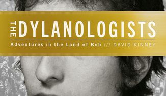 "This book cover image released by Simon and Schuster shows ""The Dylanologists: Adventures in the Land of Bob,"" by David Kinney. (AP Photo/Simon and Schuster)"