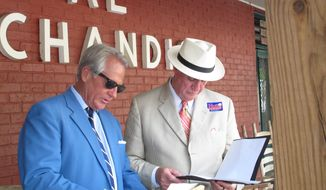 Master of Ceremonies Tommy Brittain, left, and former state Sen. John Land, right, study the list of speakers at the Galivants Ferry Stump Monday, May 12, 2014, in Galivants Ferry, S.C. Democratic candidates have been coming to the stump since the 1870s, but they are all underdogs this year in South Carolina. (AP Photo)