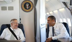 President Barack Obama talks with Senate Majority Leader Harry Reid, D-Nev. aboard Air Force One, en route to West Virginia for Sen. Robert Byrd's memorial service, July 2, 2010. (Official White House Photo by Pete Souza)