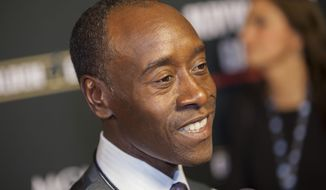 "FILE - In this Sept. 14, 2013 file photo, Don Cheadle arrives at the VIP Pre-Fight Party for the One: Mayweather vs. Canelo Fight at the MGM Grand Garden Arena in  Las Vegas. The Greater Cincinnati & Northern Kentucky Film Commission announced Monday, May 12, 2014, the filming plans for the Miles Davis biopic ""Miles Ahead"" is set to film in Cincinnati this summer. Cheadle will star as Davis with Ewan McGregor and Zoe Saldana. Cheadle is also a producer, and wrote the screenplay with Steven Baigelman. (Photo by Eric Jamison/Invision/AP, File)"