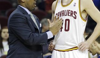 In this April 9, 2014 photo, Cleveland Cavaliers head coach Mike Brown talks to Tyler Zeller during an NBA basketball game against the Detroit Pistons in Cleveland. On Monday, May 12, 2014, the Cavaliers announced Brown has been released as head coach. (AP Photo)