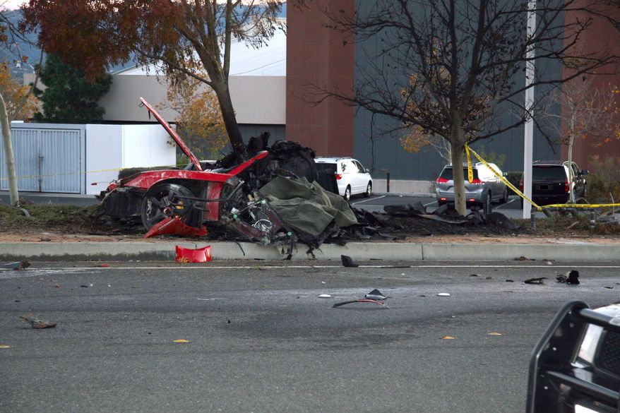 """FILE - This Nov. 30, 2013 file photo released by the Los Angeles County Sheriff Department on Tuesday, March 25, 2014, shows the wreckage of a Porsche that crashed into a light pole in Valencia, Calif. Crash investigators have determined that the car carrying """"Fast & Furious"""" star Paul Walker was traveling approximately 90 mph when it lost control on a city street and smashed into a light pole, killing the actor and his friend Roger Rodas. Kristine Rodas, the wife of Rodas, who was driving the car that crashed and killed him and Walker, sued Porsche in Los Angeles Superior Court on Monday May 12, 2014, alleging the sports car malfunctioned and caused the accident. (AP Photo/Los Angeles County Sheriff, file)"""
