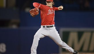 Los Angeles Angels starting pitcher C.J. Wilson pitches against the Toronto Blue Jays during first inning American League baseball action in Toronto on Monday, May 12, 2014.  (AP Photo/The Canadian Press, Frank Gunn)