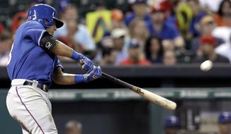 Texas Rangers' Rougned Odor connects for a solo homer against the Houston Astros in the sixth inning of a baseball game Monday, May 12, 2014, in Houston. (AP Photo/Pat Sullivan)