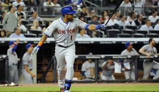New York Mets' Chris Young watches his two-run home run off of New York Yankees relief pitcher Preston Claiborne in the eighth inning of an interleague baseball game at Yankee Stadium on Monday, May 12, 2014, in New York. (AP Photo/Kathy Kmonicek)
