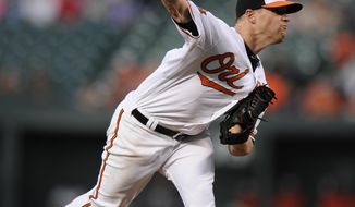 Baltimore Orioles starting pitcher Bud Norris delivers a pitch against the Detroit Tigers during the first inning of a baseball game, Monday, May 12, 2014, in Baltimore. (AP Photo/Nick Wass)