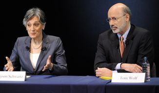 U.S. Rep. Allyson Schwartz, left, answers a question as businessman Tom Wolf looks on during the Pennsylvania Democratic Gubernatorial Primary Debate on Monday, May 12, 2014, in Philadelphia. Monday's debate is the final among the democratic gubernatorial candidates vying for the chance to challenge incumbent Pennsylvania Gov. Tom Corbett in the November election. (AP Photo/Michael Perez)