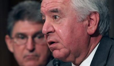 Rep. Nick J. Rahall II and Sen. Joe Manchin III (rear) are Democrats from a conservative state. (Associated Press)