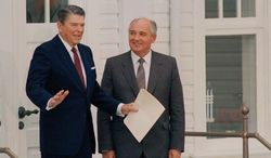 U.S. President Ronald Reagan gestures as Soviet leader Mikhail Gorbachev looks on after their third session of talks at the Hofdi in Reykjavik, Oct. 12, 1986. (AP Photo/Ron Edmonds)
