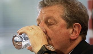 England's soccer manager Roy Hodgson, takes a sip of water during the press conference announcing the squad for the World Cup in Brazil at Vauxhall headquarters,  in Luton, England, Monday, May 12, 2014.  England coach Roy Hodgson selected a World Cup squad containing several young players on Monday, although Frank Lampard was among the veterans to still make the cut. (AP Photo/Sang Tan)