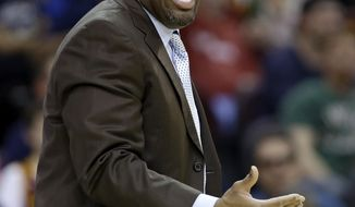 Cleveland Cavaliers head coach Mike Brown argues a call during the second quarter of an NBA basketball game against the Boston Celtics Saturday, April 12, 2014, in Cleveland. Boston defeated Cleveland 111-99. (AP Photo/Tony Dejak)