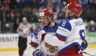 Russia defender Denis Denisov, left and forward Alexander Ovechkin celebrate a goal during the Group B preliminary round match between Russia and USA at the Ice Hockey World Championship in Minsk, Belarus, Monday, May 12, 2014. (AP Photo/Darko Bandic)