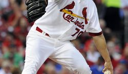 St. Louis Cardinals' starting pitcher Tyler Lyons throws against the Chicago Cubs in the first inning in a baseball game, Monday, May 12, 2014, at Busch Stadium in St. Louis. (AP Photo/Bill Boyce)