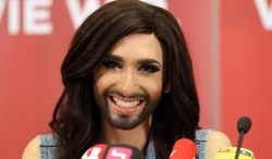 Austrian singer Conchita Wurst attends a press conference in Vienna, Austria, on Sunday, May 11, 2014.  Bearded drag queen Conchita Wurst has made a triumphant return to Austria after winning the Eurovision Song Contest in Copenhagen Saturday,  in what the country's president called a victory for tolerance in Europe. (AP Photo/Ronald Zak)