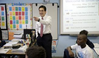 House Majority Leader Eric Cantor visits with students at the Bronx Charter School of Excellence in New York, Monday, May 12, 2014. Cantor visited the New York City charter school as part of his national education policy tour. (AP Photo)