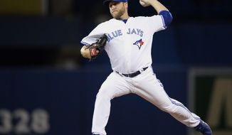 Toronto Blue Jays starting pitcher Mark Buehrle pitches against the Los Angeles Angels during first inning American League baseball action in Toronto on Monday, May 12, 2014. (AP Photo/The Canadian Press, Frank Gunn)
