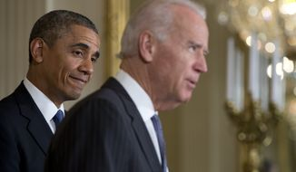 President Obama, left, looks to Vice President Joe Biden as he speaks at a ceremony in East Room of the White House in Washington, May 12, 2014. (Associated Press) ** FILE **