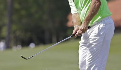 Lee Westwood, of England, chips into the third green during the second round of The Players championship golf tournament at TPC Sawgrass, Friday, May 9, 2014, in Ponte Vedra Beach, Fla. (AP Photo/Lynne Sladky)