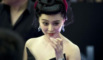 "Chinese actress Fan Bingbing arrives at the red carpet for her latest movie ""X-Men:Days of Future Past"" in Beijing, China, Tuesday, May 13, 2014.  (AP Photo/Ng Han Guan)"