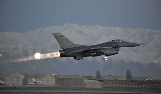 A U.S. Air Force F-16 Fighting Falcon takes off on a mission at dawn from Bagram Airfield, Afghanistan, Feb. 11, 2014. The aircraft and crews at Bagram are prepared to fly 24 hours a day. (U.S. Air Force photo by Senior Master Sgt. Gary J. Rihn/Released) ** FILE **