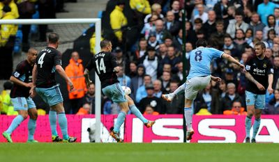 Manchester City's Samir Nasri, second right, scores his side's first goal during the English Premier League soccer match between Manchester City and West Ham at the Etihad Stadium in Manchester, England, Sunday May 11, 2014.  (AP Photo/Jon Super)