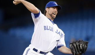 Toronto Blue Jays starting pitcher R.A. Dickey throws against the Cleveland Indians during the first inning of a baseball game in Toronto on Tuesday, May 13, 2014. (AP Photo/The Canadian Press, Frank Gunn)
