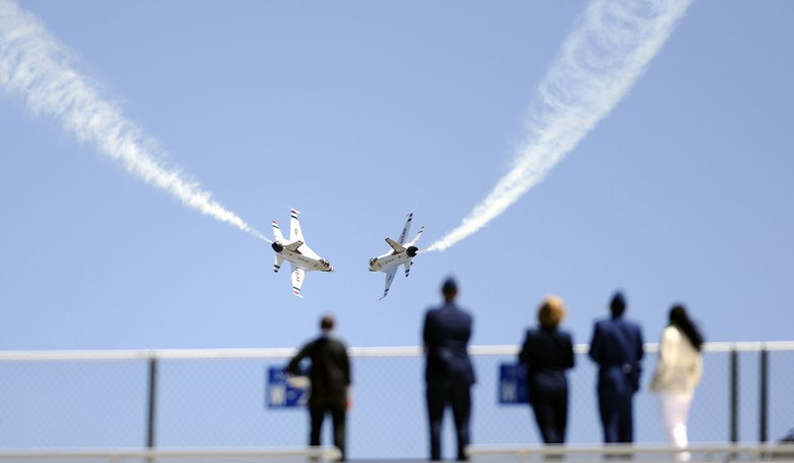 The U.S. Air Force Thunderbirds execute a maneuver while visitors watch from Falcon Stadium after the graduation ceremonies of the Class of 2009. This was the 51st graduating class, and consisted of 1,046 newly commissioned 2nd Lieutenants (US Air Force photo by Dennis Rogers)
