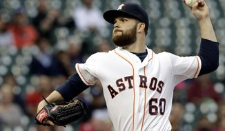 Houston Astros' Dallas Keuchel delivers a pitch against the Texas Rangers in the first inning of a baseball game Tuesday, May 13, 2014, in Houston. (AP Photo)