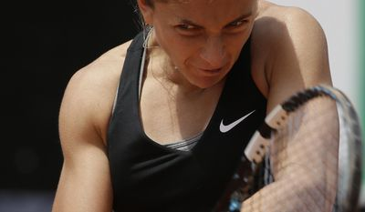 Italy's Sara Errani returns the ball to Chanelle Scheepers of South Africa at the Italian Open tennis tournament, in Rome, Tuesday, May 13, 2014. (AP Photo/Alessandra Tarantino)