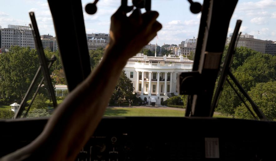 """""""Marine One approaches the South Lawn of the White House. I had asked the President's military aide if the pilot would let me photograph the approach from the cockpit, which yielded this photograph."""" (Official White House Photo by Pete Souza)"""