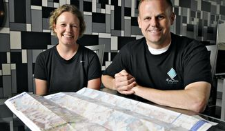 ADVANCE FOR USE MONDAY, MAY 19 - In this photo taken on Monday, May 12, 2014, Amber Kangas and Randy Ray, Sauk Rapids, Minn., talk about their adventure to Mount Everest. The couple were near the south base camp of Mount Everest in Nepal when an avalanche killed more than a dozen guides near another base camp on April 18, 2014.  (AP Photo/St. Cloud Times, Jason Wachter)