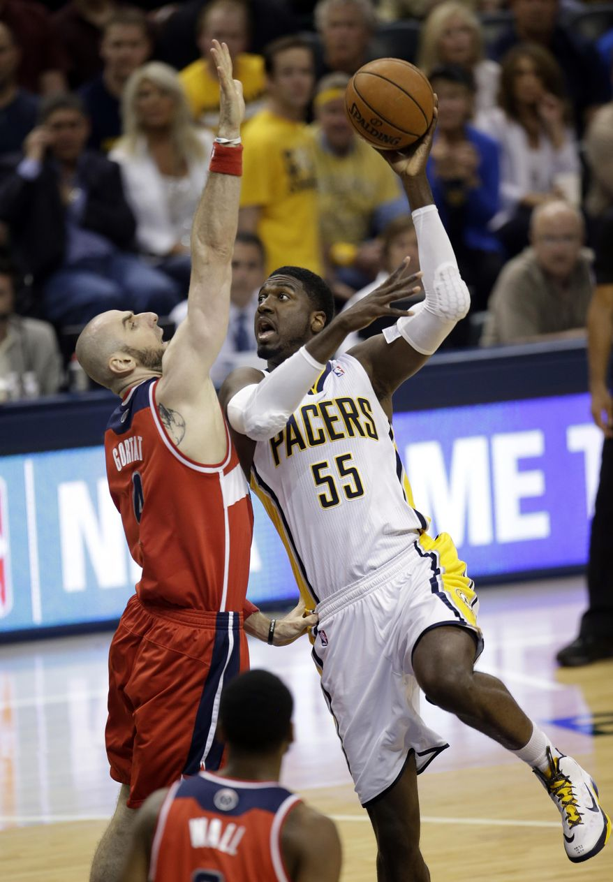 Indiana Pacers center Roy Hibbert (55) shoots over Washington Wizards center Marcin Gortat during the first half of game 5 of the Eastern Conference semifinal NBA basketball playoff series Tuesday, May 13, 2014, in Indianapolis. (AP Photo/AJ Mast)