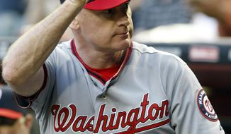 Washington Nationals manager Matt Williams (9) acknowledges the crowd before a game against the Arizona Diamondbacks, Monday, May 12, 2014, in Phoenix. (AP Photo/Rick Scuteri)