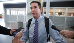 ** FILE ** Glenn Greenwald speaks to the media after arriving at John F. Kennedy International Airport, on Friday, April 11, 2014, in New York. (AP Photo/John Minchillo)