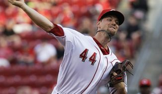 Cincinnati Reds starting pitcher Mike Leake throws against the San Diego Padres in the first inning of a baseball game, Tuesday, May 13, 2014, in Cincinnati. (AP Photo)
