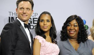 "FILE - This Feb. 1, 2013 file photo shows, from left, actors Tony Goldwyn,  and Kerry Washington from the ABC series ""Scandal,"" with series creator Shonda Rhimes at the 44th Annual NAACP Image Awards in Los Angeles. ABC says it is adding a dozen new series to its schedule next season, including its third drama from producer Shonda Rhimes. Viola Davis will star in the new series from Rhimes, a legal thriller titled ""How to Get Away with Murder."" Rhimes produces ""Scandal"" and ""Grey's Anatomy,"" which will be returning to the ABC schedule. (Photo by Chris Pizzello/Invision/AP, FIle)"