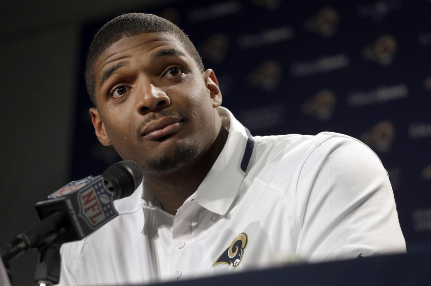 St. Louis Rams seventh-round draft pick Michael Sam listens to a question during a news conference at the NFL football team's practice facility Tuesday, May 13, 2014, in St. Louis. (AP Photo/Jeff Roberson)