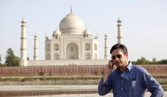 "This image released by Disney shows Jon Hamm in a scene from ""Million Dollar Arm."" (AP Photo/Disney, Ishika Mohan)"