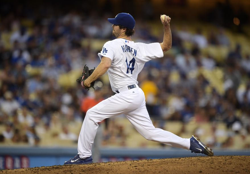 Los Angeles Dodgers starting pitcher Dan Haren throws to the plate during the second inning of a baseball game against the Miami Marlins, Monday, May 12, 2014, in Los Angeles.  (AP Photo)