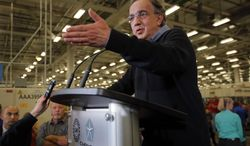 Chrysler Group LLC Chairman and CEO Sergio Marchionne speaks with the media after the dedication a of transmission manufacturing facility in Tipton, Ind., Tuesday, May 13, 2014. (AP Photo/AJ Mast)