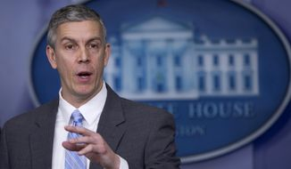 FILE - This March 14, 2014 file photo shows Education Secretary Arne Duncan speaking in the Brady Press Briefing Room of the White House in Washington. Student lender Sallie Mae has reached a $60 million settlement with the federal government to resolve allegations it charged military service members excessive interest rates on their student loans. The settlement was announced Tuesday by Attorney General Eric Holder and Duncan. (AP Photo/Manuel Balce Ceneta, File)