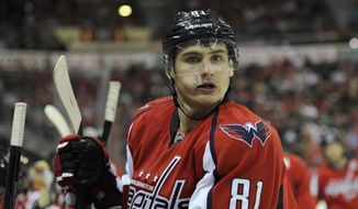 **FILE** Washington Capitals defenseman Dmitry Orlov (81), of Russia, looks on during the second period an NHL hockey game against the Anaheim Ducks, Monday, Dec. 23, 2013, in Washington. (AP Photo/Nick Wass)