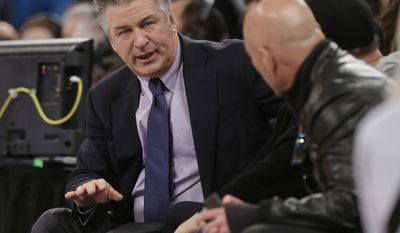 Alec Baldwin talks to Howie Mandel during the first half of an NBA basketball game between the New York Knicks and the Brooklyn Nets Wednesday, April 2, 2014, in New York.  (AP Photo/Frank Franklin II)