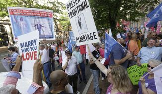 Supporters of traditional marriage and gay marriage demonstrate outside the Federal Appeals Court in Richmond, Va., Tuesday, May 13, 2014. (AP Photo/Steve Helber, file) ** FILE **