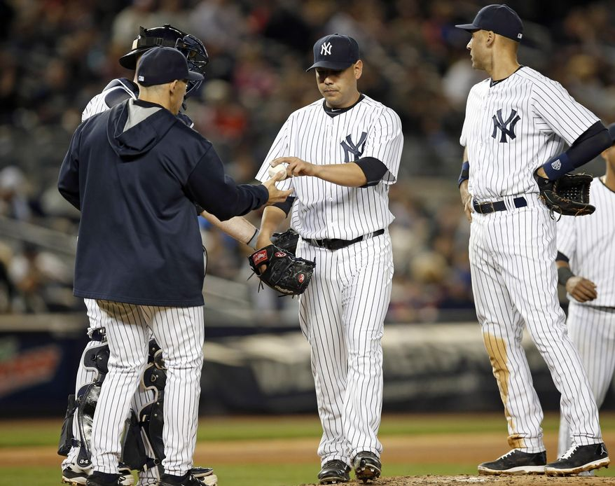 New York Yankees manager Joe Girardi, left, takes the ball from Yankees starting pitcher Vidal Nuno in the fourth inning of a baseball game against the New York Mets at Yankee Stadium in New York, Tuesday, May 13, 2014. New York Yankees shortstop Derek Jeter joins Nuno on the mound during the pitching change. (AP Photo)